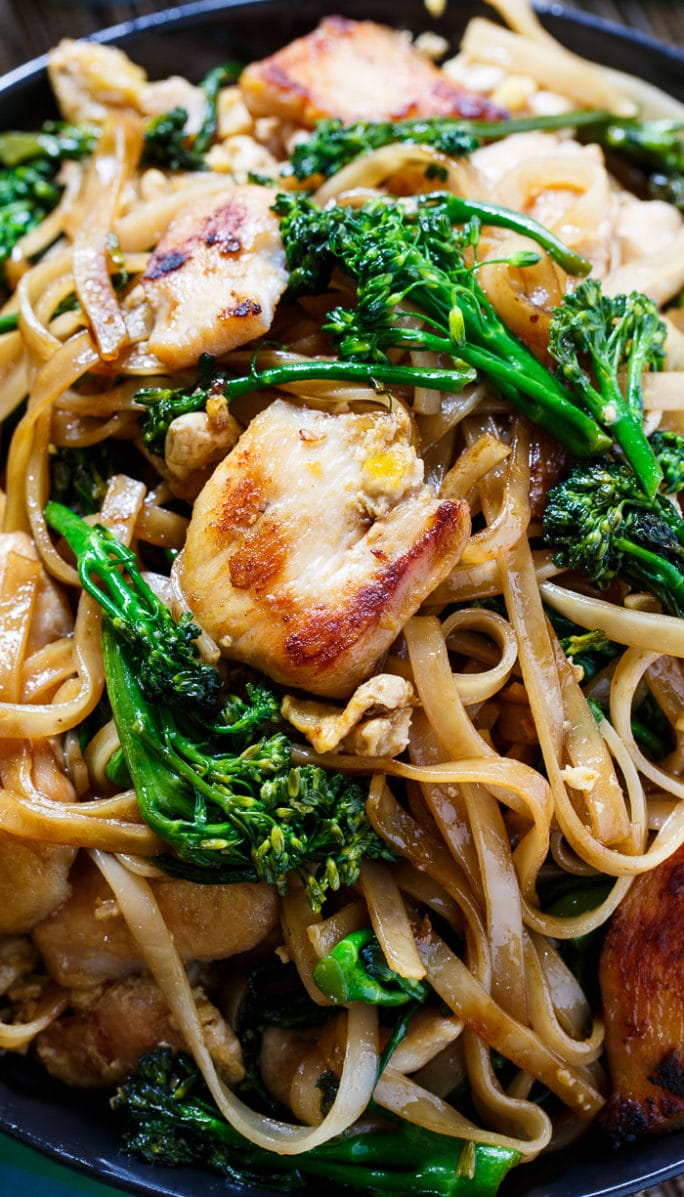 Close-up of Thai Stir-Fried Noodles with Chicken and Broccolini.