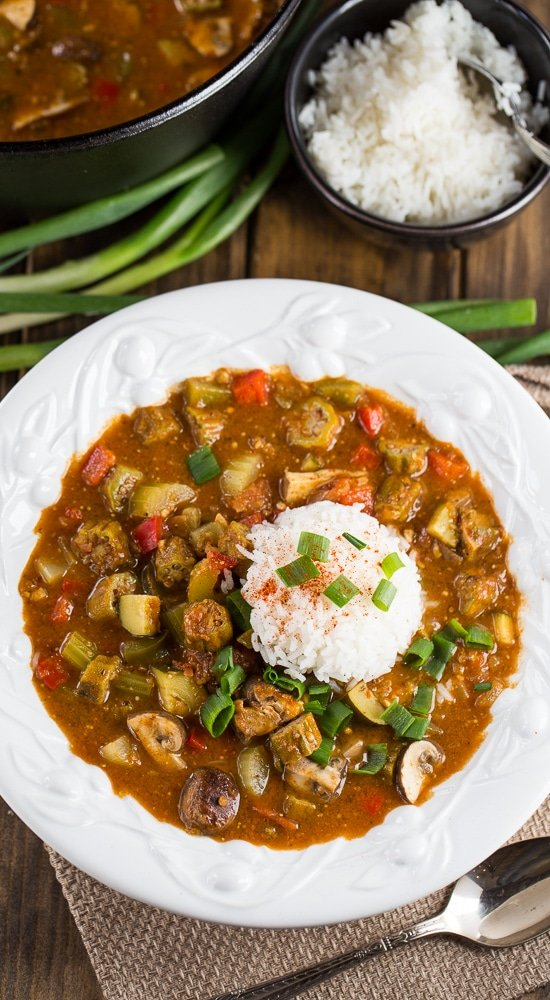 Vegetarian Gumbo made with a rich, dark roux and red beans, okra, mushrooms, zucchini, and bell peppers.