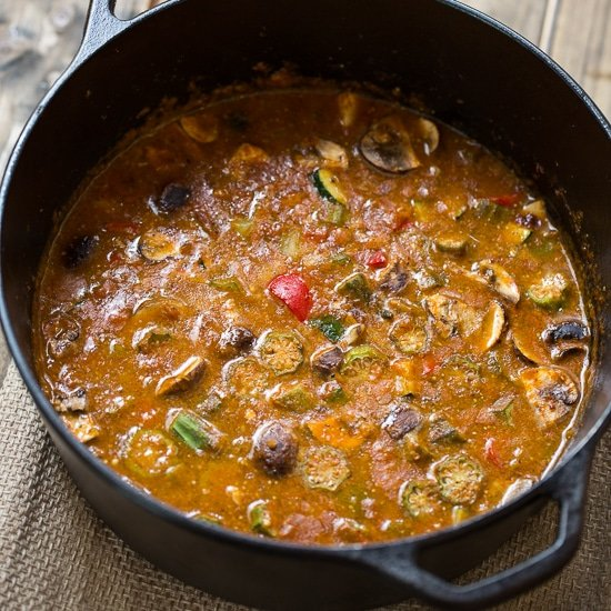 Vegetarian Gumbo made with a rich, dark roux and okra, bell peppers, red beans, zucchini, and mushrooms.